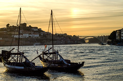 View (LynxDaemon) Tags: sunset porto portugal bridge arch city town boat sailing water river clouds