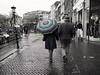 Under her umbrella (weerwolfje) Tags: bnw bw street streetphotography utrecht umbrella stripes olympusomdmark2