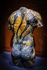 Tattooed torso (Thad Zajdowicz) Tags: leica tattoo zajdowicz losangeles california naturalhistorymuseumoflosangelescounty usa travel color indoor inside colour vignette availablelight lightroom torso art anthropology ethnology nude light shadow red silicone