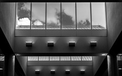 Promenade, Miami International (irrational.photography) Tags: rational irrational irrationalphoto irrationalphotography rationalphotography photography irrationalphotographyrationalphotography black white monocrhome grey old vintage contrast film grain noise bw gray scale grayscale monochrome architecture up ceiling look looking tilt light cloud glass rectangle support window sky skylight atrium symmetry building structure line indoor outdoor
