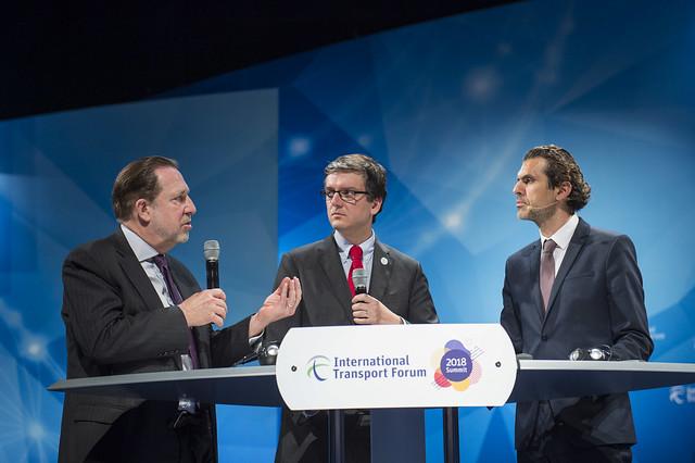 Michael Replogle, Miguel Gaspar and Ali Aslan discussing