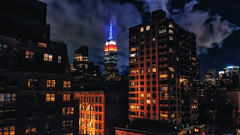 Empire State Building - New York (Patrik S.) Tags: new york manhattan empire state building usa landmark night dark cloud illuminated appartement gotham city batman skyscraper attraktion bewölkt wolke dunkel nacht nuit stadt ville sky red blue skyline light himmel rot blau bleu rouge ciel hell beleuchtet lumix nik collection fz1000 adobe lightroom dachterrasse dach roof rooftop ruhig quiet that never sleeps ngc