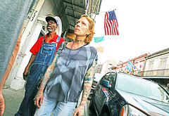 The Americans (kirstiecat) Tags: neworleans america unitedstates louisiana flag usflag people strangers woman tattoos street canon