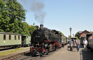 Steam locomotive No. 99 758 awaits departure time at Bhf Bertsdorf Junction with its train to Jonsdorf on the Zittauer Schmalspurbahn.