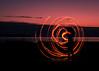 Winding Down (Prestidigitizer) Tags: lightpainting flame burning flaming hulahoop circus beach sunset longexposure le pentaxk3 pentaxda50135mm spinning