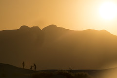 Candid shot at White Sands (Mitch Tillison Photography) Tags: whitesands nationalmonument park scenic sunset silhouette gold tones lensflare mountain family dunes golden moment candid mitchtillison photo photography nikon d810 nikkor 200500
