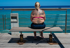 Protaras, Cyprus, 2018. (CWhatPhotos) Tags: cwhatphotos 2018 april digital camera pictures picture image images photo photos foto fotos that have which contain olympus seafront golden coast beach blue sky skies holiday water sea deep color colour 43 micro four thirds penf protaras cyprus eastern woman women with tattoos tattoo tattooed tatts tat ink inked bikini top back milf rear behind seated sit sitting down