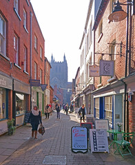 Hereford City centre with the cathedral in the background. (Minoltakid) Tags: hereford herefordshire england uk streetphotography photograph street city minoltakid theminoltakid rossevans rossdevans shops buildings sony sonyrx0 rx0