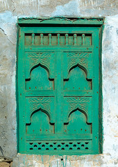 Wooden carved window of an abandoned house, Dhofar Governorate, Mirbat, Oman (Eric Lafforgue) Tags: abandoned arabia arabianpeninsula arabic arabicarchitecture arabicstyle architecture buildingexterior carved carvedwindow carvingcraftproduct colorimage day decrepit dhofar dhufar exteriorview facade ghosttown green gulfcountries habitation history house houseexterior mirbat moscha nopeople old oldhouse oman oman18202 outdoors sultanate thepast traveldestination traveldestinations vertical weathered window woodenwindow dhofargovernorate om