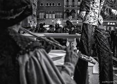 The Jester (evanffitzer) Tags: bw blackandwhite lasvegas vegas monochrome flute jester fujix100s fujifilmx100s indoors plaza opera stilts evanfitzer evanffitzer