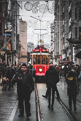 On the tracks (Anthony P.26) Tags: beyoglu category istanbul places street tram transport travel turkey transportation rail tracks pedestrian phones people shoppers rain damp reflections cobblestone paving streetphotography canon1585mm canon70d canon outdoor travelphotography