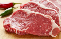 iStock_000017953038Medium (lletresynombres) Tags: steak newyorksteak stripsteak raw beef meat redmeat cutlet cuttingboard pepper jalapenopepper vegetable produce chilepepper fresh wood woodgrain fat marbling red green multiple many stacked mound horizontal nobody