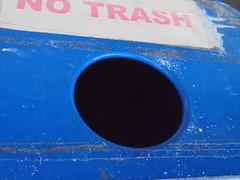 DSC02426 (classroomcamera) Tags: blue circle circles hole holes black center centered sign signs signage no trash ban bans banning garbage recycle recycles recycling mail mailbox box boxes mailboxes closeup abstract