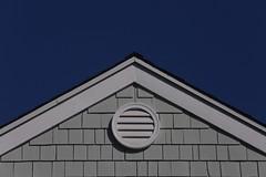 A Gable and Blue Skies (amarilloladi) Tags: rooftop roof shingles beachhouse california balboaisland minimal sooc landscapes blue siding blueskies buildings house 7dwf gable
