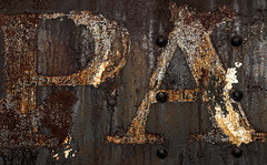 Devolution (Junkstock) Tags: aged arizona bard corrosion corroded craquelure decay distressed decayed graphics graphic iron old oldstuff oldandbeautiful paint peelingpaint rust rusty rusted rustyandcrusty relic railroad rivets textures texture typography type trains train text weathered yuma