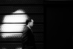 Wolf on Wall Street (westdoorx) Tags: people person candid chicago loop downtown suit portrait street light dramatic lighting black white bw blackandwhite blackwhite monochrome