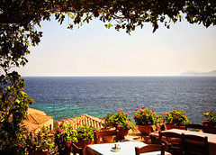 All senses satisfied (jimiliop) Tags: restaurant taverna greek view sea garden flowers plants table chairs cuisine greece peloponese monemvasia aegean town roofs horizon green blue senses decoration summer seaview tablewithaview lunch