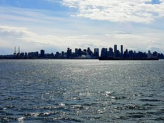 City by the sea (walneylad) Tags: vancouver britishcolumbia canada downtown skyline buildings towers condos urban burrardinlet sea ocean inlet pacificocean water waves light glistening sun clouds silver port ship freighter tanker april spring afternoon view nature scenery cityscape highrises harbour maritime