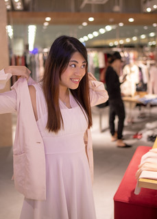 Young woman shopping in shopping mall in Singapore