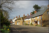 High Street, Braunston (Jason 87030) Tags: shops cottages house home braunston light flowers tree stone affs daffodils yellow splash colour hovius bread bakers plough pub local walk leaflets clayton march 2018 unitedkingdom greatbritain english nice roadside sony alpha a6000 ilce nex lens tag