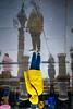 The Upside Down (Sean Batten) Tags: london england unitedkingdom gb trafalgarsquare reflection rain water yellow person candid streetphotography street city urban nikon df 50mm