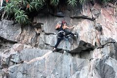 Sport climbing (wesp2011) Tags: woman climbing rocks mountaineering sport plants rope helmet safe