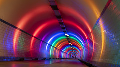 underground rainbow (Blende1.8) Tags: illuminated illumination light colour color colors colorful colourful vivid rainbow underground tunnel tunnelblick tunnelview antwerp antwerpen sintannatunnel urban city bunt farbenfroh sony alpha a6300 ilce6300 18135mm sel18135 rot red orange belgium belgien vlaanderen flandern unterführung untergrund architecture curves lines vanishingpoint fluchtpunkt life curvy street people pedestrian pedestrians