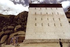 Tibet. (slide 2003) (vittorio vida) Tags: tibet asia china monastery rocks painting graffiti murale buildings architecture temple