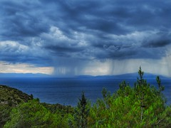 rain over the sea (panoskaralis) Tags: sea sky water landscape mountain bay grass tree forest pine rain rainyday clouds skyclouds dark mood seaview aegean aegeansea storm lesvos lesvosisland mytilene greece greek hellas hellenic nikon nikonb700