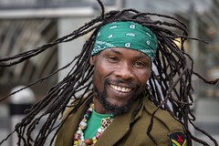 Stranger 63/100 'Jah' (Leanne Boulton) Tags: 100strangers urban street pose posed portrait portraiture streetphotography streetportrait eyecontact streetlife man male rasta face eyes dreadlocks movement motion hair style fashion swirling action smile smiling emotion mood feeling energy dynamic green character tone texture detail depthoffield bokeh naturallight outdoor light shade city scene human life living humanity society culture people canon canon5dmkiii ef2470mmf28liiusm color colour glasgow scotland uk