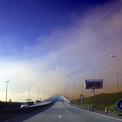 Pont de Normandie, France (pom'.) Tags: rn1029 estuairedelaseine pontdenormandie may 2018 panasonicdmctz101 haze sky clouds bridge river seine seinemaritime 76 lehavre road roadpicture fromamovingvehicle normandie france europeanunion 100 200 300