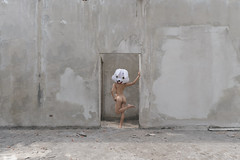 rabbit hole (@_polod_) Tags: fine art nude woman asian girl rabbit hole alice wonderland empty minimalist back opposite mask mascott weird weirdo door centered urbex nurbex strange abandoned concrete wall white smooth turned