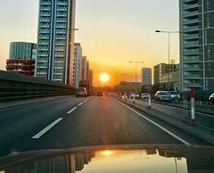 Driving towards the rising sun (Winniepix) Tags: east tower city car drive orange london newham road sun sunrise