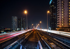 Waiting for the Sky Train (Matt Molloy) Tags: mattmolloy photography night street lights roads traintracks highway traffic trails buildings skyscrapers architecture busy city kingtaksinbridge chaophrayariver sathon bangkok thailand cityscape lovelife