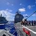 Sailors aboard the USS Antietam conduct a replenishment-at-sea exercise with the Indian Deepak-class fleet tanker INS Shakti