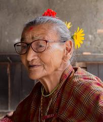 Spinning wheel lady (SamKirk9) Tags: nepal kathmandu bhaktapur