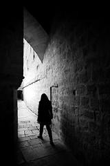 (cherco) Tags: woman mujer blackandwhite blancoynegro backlighting solitario solitary silhouette silueta shadow sombra street solo sombras arquitectura alone architecture arch arco walk lonely light luz loner l stone piedra salida exit eos 5d composition composicion canon ciudad city calle chica canoneos5diii tunnel bnw