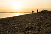 Walking the Shore (hutchyp) Tags: walking walkers warsash shore beach southamptonwater solent sunset shingle hampshire sea sony alpha a58