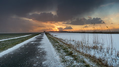 A rough but lovely winter sunset (Rob Schop) Tags: wideangle grootammers landscape hoyaprofilters sonya6000 f10 nederland outdoor weather clouds groothoek fietspad sunset pola broekmolen samyang12mmf20 oudalblas snow a6000 winter wolken ice