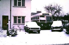 Slide 116-87 (Steve Guess) Tags: snow byfleet surrey england gb uk bpv8 aec regal iv ipswich ict bus q159vmd ford escort estate 768pph prefect 107e car