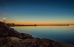 Sundown in Petoskey (T P Mann Photography) Tags: petoskey michigan longexposure color sundown sunset reflections water sea seascape lake bay lakemichigan littletraversebay clocktower pier breakwall lighthouse dusk bluehour