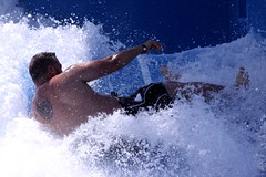 wipeout while Flowriding on Navigator of the Sea's cruise (miosoleegrant2) Tags: wipeout flowriding water ride waves man male guy flowrider flowboarding flow riding riders boarder wave house surf rider machine surfing fake sport outdoor hands guys blue pits armpits thighs hairy legs cruise backs shorts wet men arms swimwear feet people stud studs dude dudes virile manly masculine swim