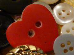 Follow your heart!!  P1050293 (amalia_mar) Tags: 7dwf macro closeup buttons heart coeur macroobjects stilllife red macromademoiselle