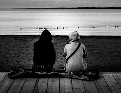 Kindred Spirits (Gavin S Photography) Tags: barrie blackandwhite blanket clouds couple dusk goldenhour grain hoodie kempenfeltbay lake landscape sand shadow silhouette sky skyscape twilight beach girls ontario canada ca