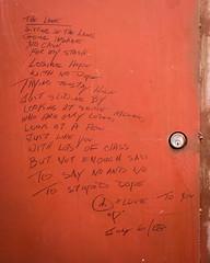 The Lane. (yeahwotever) Tags: poem poet poetry drug heroin down laneway south lane 100 east hastings street lock steel graffiti writing wall addict addiction door stash cash dope hope loser stupid insane