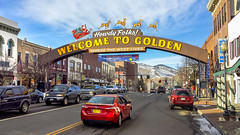 Welcome To Golden at Christmastime (photographyguy) Tags: goldencolorado welcometogolden december colorado santa sleigh street road rockies rockymountains cellphonephotography sign cars washingtonstreet howdyfolks foothills