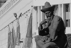 The Wise Kazakh (peterkelly) Tags: bw digital canon 6d asia gadventures centralasiaadventurealmatytotashkent kazakhstan almaty republicsquare statue beard man hat building sculpture
