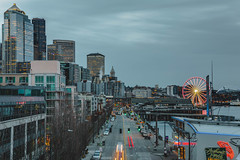 Melancholy Sky (ashpmk) Tags: seattle downtown downtownseattle city cityscape cars trails wheel ferriswheel sky grey