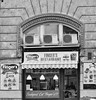 Cannibalism (tcees) Tags: wesselényist budapest hungary pest shop urban x100 fujifilm finepix bw mono monochrome blackandwhite chicken burgers sidewalk pavement street streetphotography window lights airconditioningunit restaurant wall airbrick food noticeboard building sign takeaway