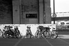 Bicycleparking in Amsterdam: organized anarchy (onemanifest) Tags: amsterdam pakhuisdezwijger docks parking bicycles order anarchy selfexpression freewill highcontrast tarmac harbor sunlight film analog blackwhite monochrome